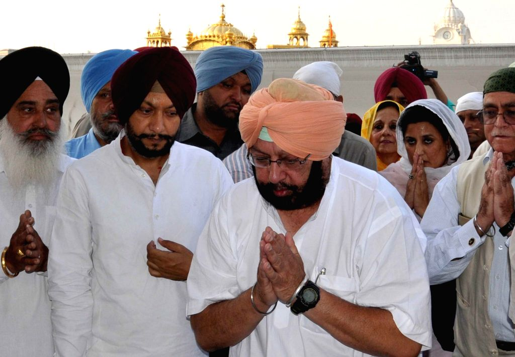 Congress candidate for 2014 Lok Sabha Election from Amritsar, Captain Amarinder Singh pays obeisance at the Golden Temple after winning Amritsar on May 16, 2014.