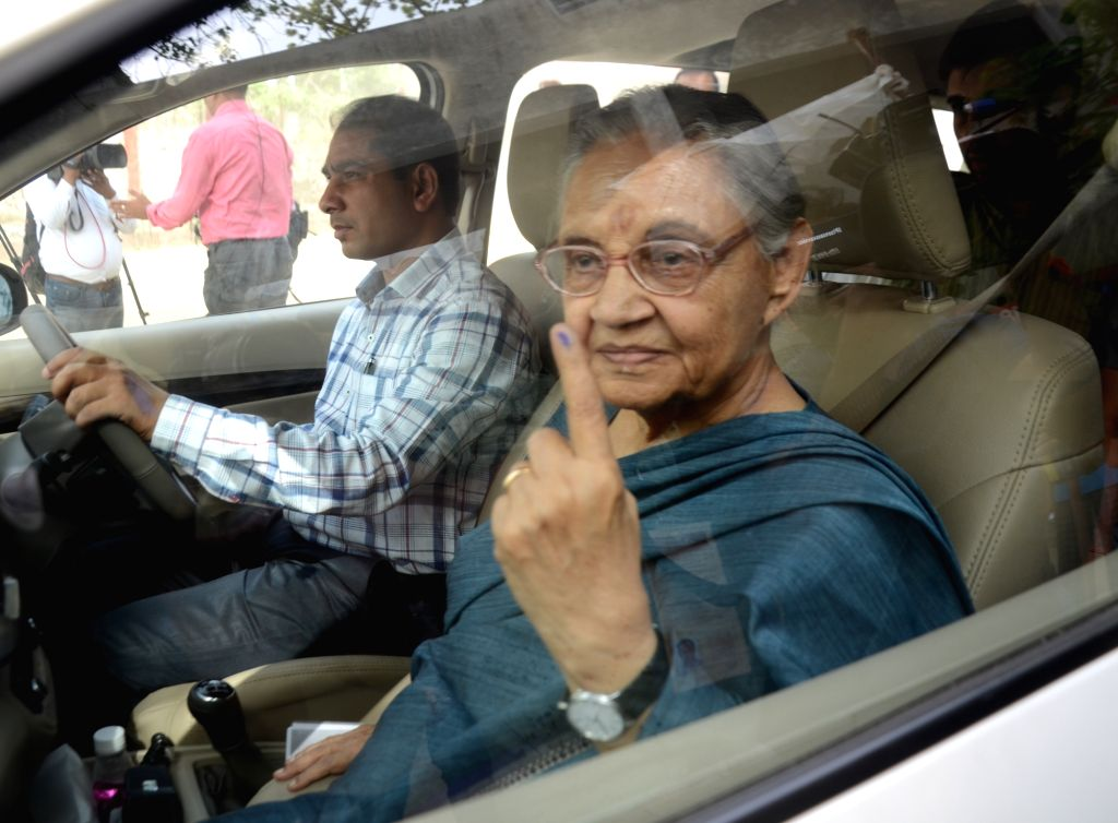 Congress candidate for North-East Delhi Lok Sabha seat, Sheila Dikshit shows her forefinger marked with indelible ink after casting vote during the sixth phase of 2019 Lok Sabha elections, ... - Sheila Dikshit