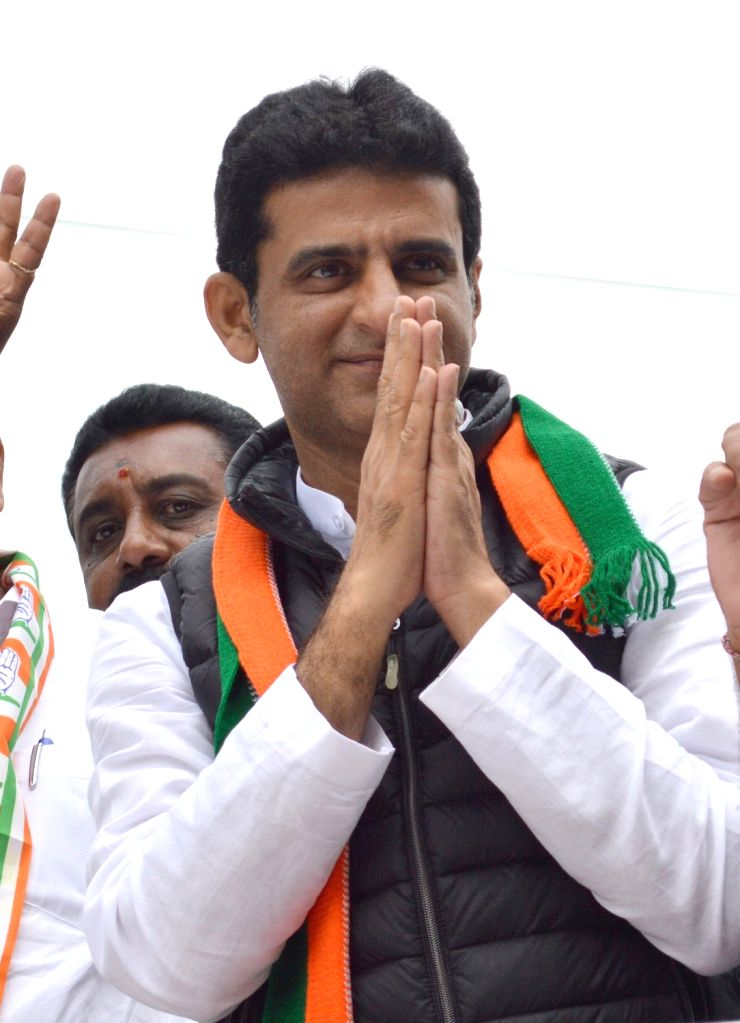 Congress candidate for Shivajinagar Assembly Constituency by polls Rizwan Arshad campaigns ahead of the bye-elections, in Bengaluru on Dec 3, 2019.