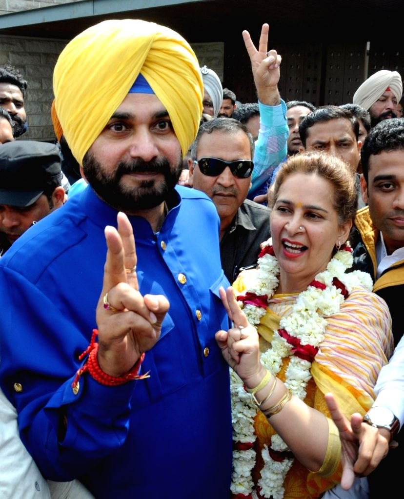 Congress candidate from Amritsar East assembly constituency Navjot Singh Sidhu with his wife Navjot Kaur Sidhu celebrate as assembly election results being announced in Amritsar on March ... - Navjot Singh Sidhu and Navjot Kaur Sidhu
