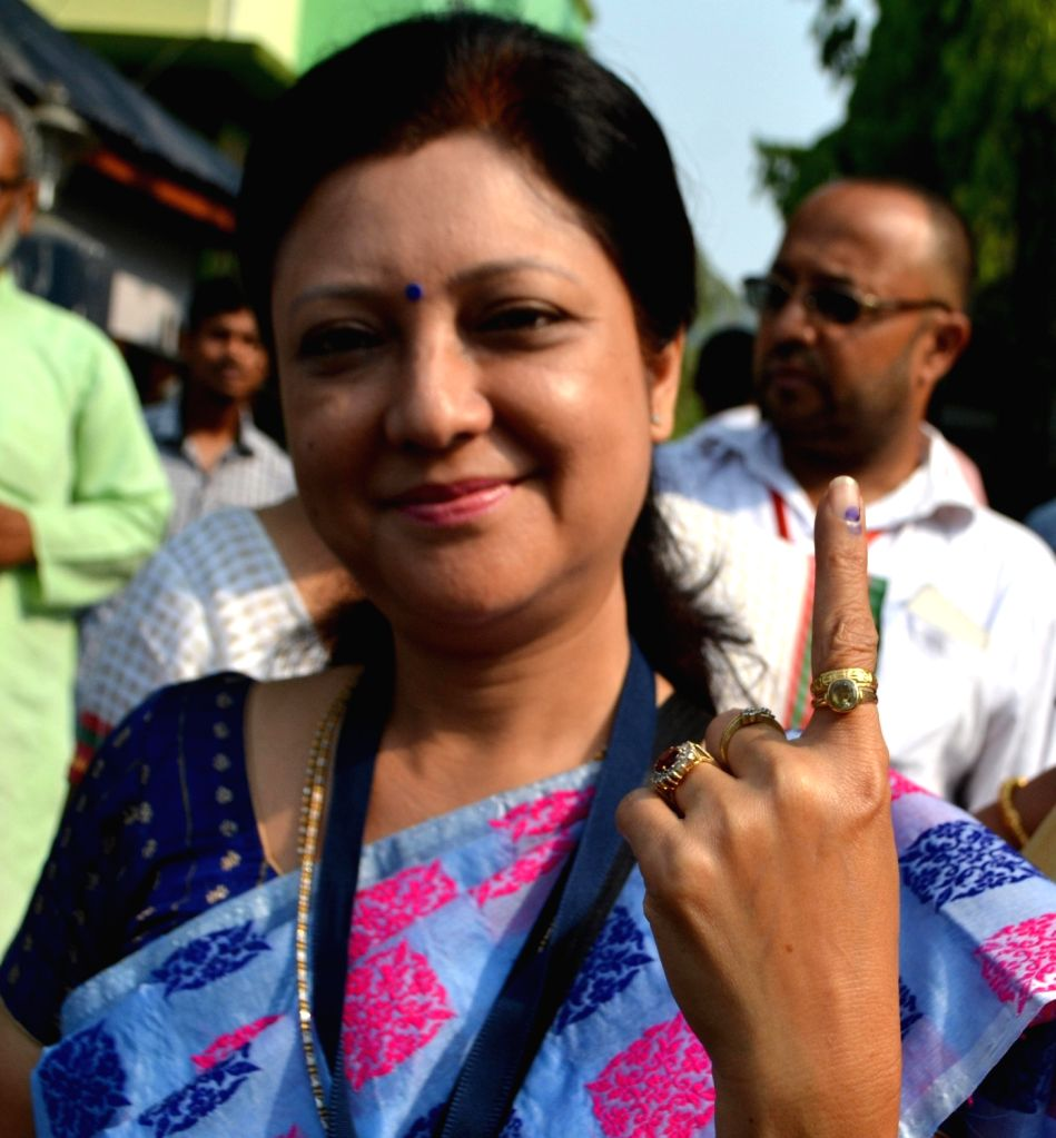 Congress candidate from Guwahati East constituency Bobbeeta Sharma shows her fore finger marked with phosphorous ink after casting his vote at a polling booth during the second phase of ... - Bobbeeta Sharma
