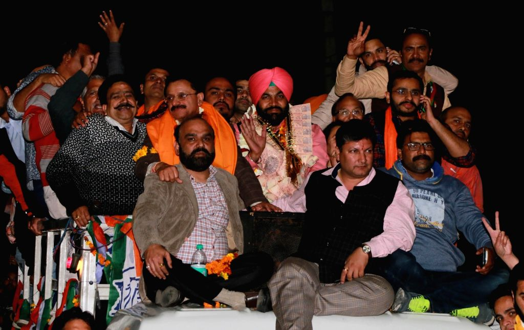 Congress candidate Gurjeet Singh celebrates after his victory in Punjab Assembly elections in Amritsar on March 11, 2017. - Gurjeet Singh
