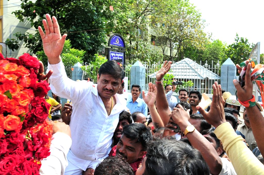 Congress candidate Muniratna who won Rajarajeshwari Nagar assembly seats in the bypoll, celebrates with party workers; in Bengaluru on May 31, 2018.