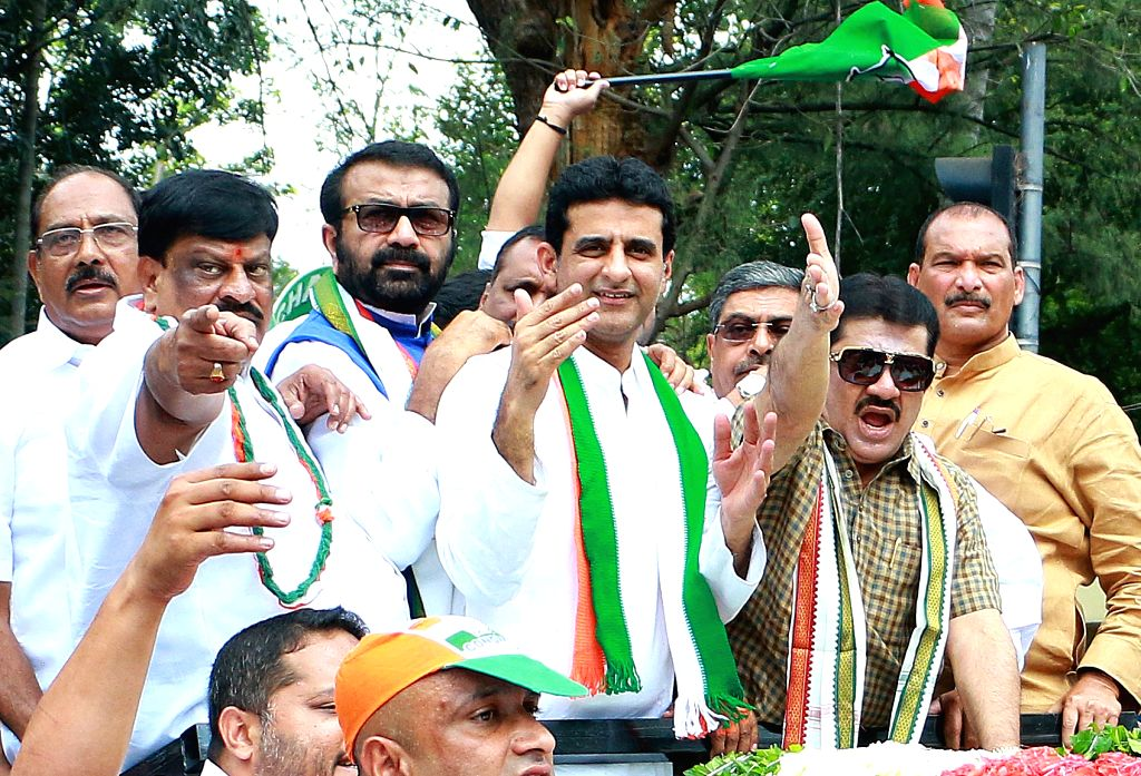 Congress candidate Rizwan Arshad accompanied by party leaders, arrives to file his nomination for bypolls to Shivaji Nagar Assembly constituency in Bengaluru on Nov 18, 2019.