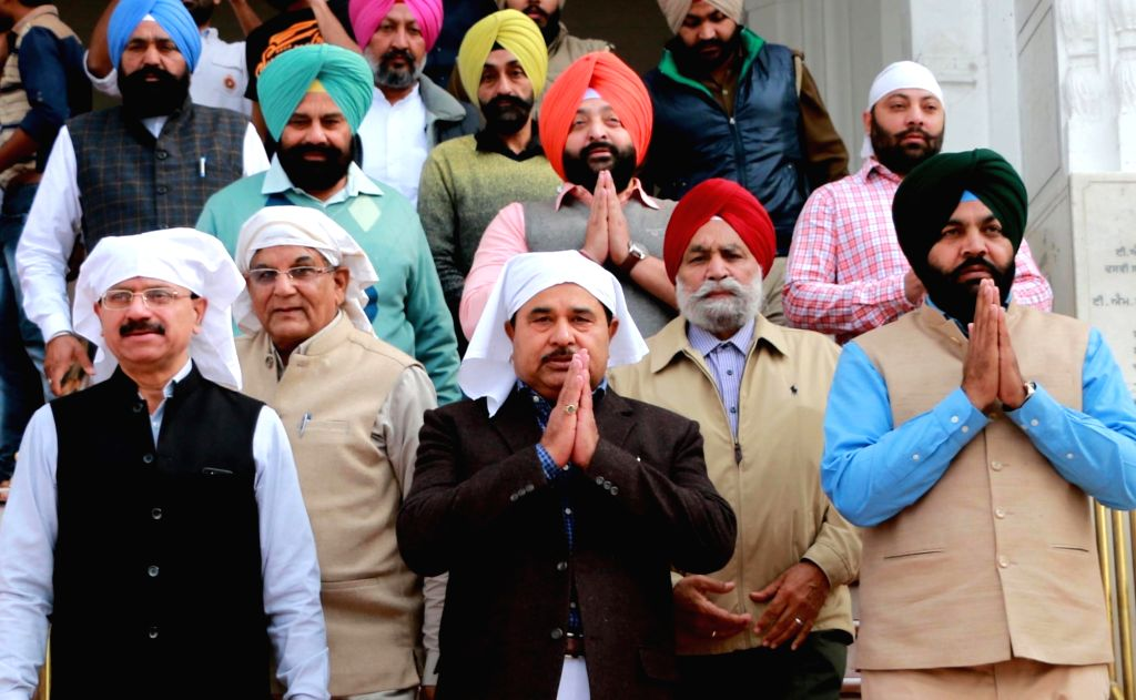 Congress candidates from Amritsar pay obeisance on the eve of counting of votes at the Golden Temple in Amritsar on March 10, 2017.
