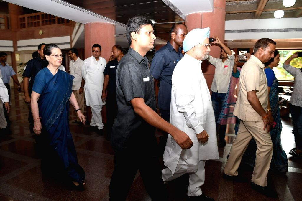 Congress chief Sonia Gandhi and former Prime Minister Manmohan Singh arrive to attend all opposition Party leaders meeting over presidential election at Parliament house library building ... - Manmohan Singh and Sonia Gandhi