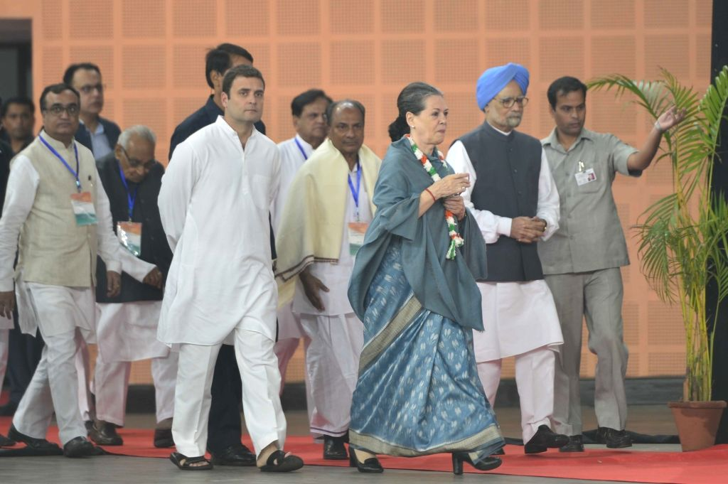 Congress chief Sonia Gandhi and Rahul Gandhi during a programme organised to pay tribute to former Prime Minister Pandit Jawaharlal Nehru on his 126th birth anniversary in New Delhi on Nov ... - Pandit Jawaharlal Nehru, Sonia Gandhi and Rahul Gandhi