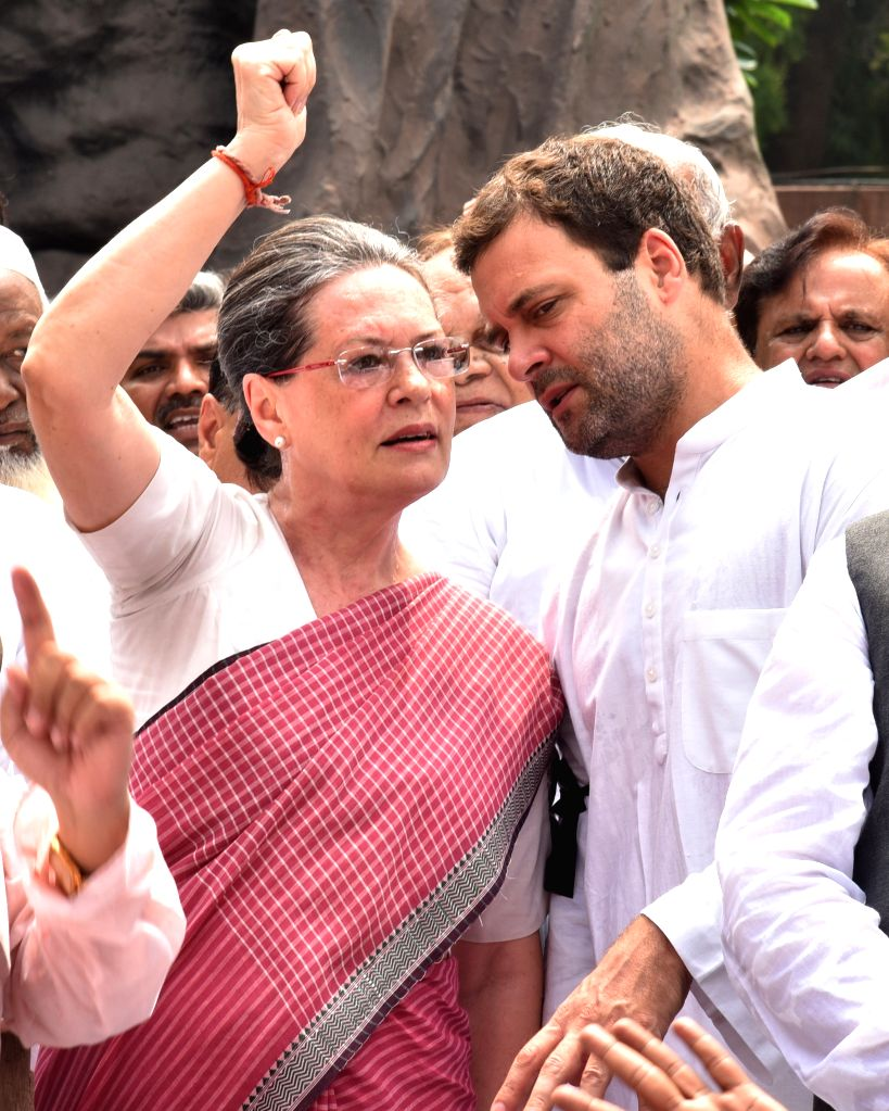Congress chief Sonia Gandhi and vice president Rahul Gandhi stage a demonstration against suspension of Congress MPs at the Parliament in New Delhi, on Aug 5, 2015. - Sonia Gandhi and Rahul Gandhi