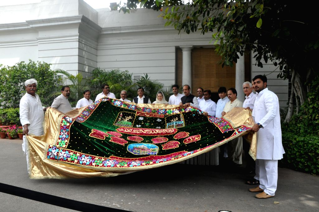 Congress chief Sonia Gandhi hands over the `Chaadar` to be offered at Dargah of Khwaja Moinuddin Chishti, Ajmer Sharif to a party delegation in New Delhi on April 21, 2015.