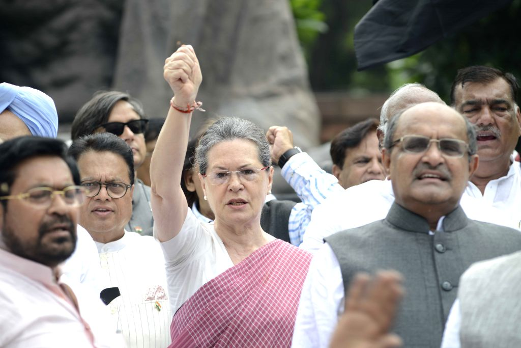 Congress chief Sonia Gandhi, JD(U) general secretary KC Tyagi, Congress MP Shashi Tharoor and other parliamentarians stage a demonstration against suspension of Congress MPs at the ... - Shashi Tharoor and Sonia Gandhi