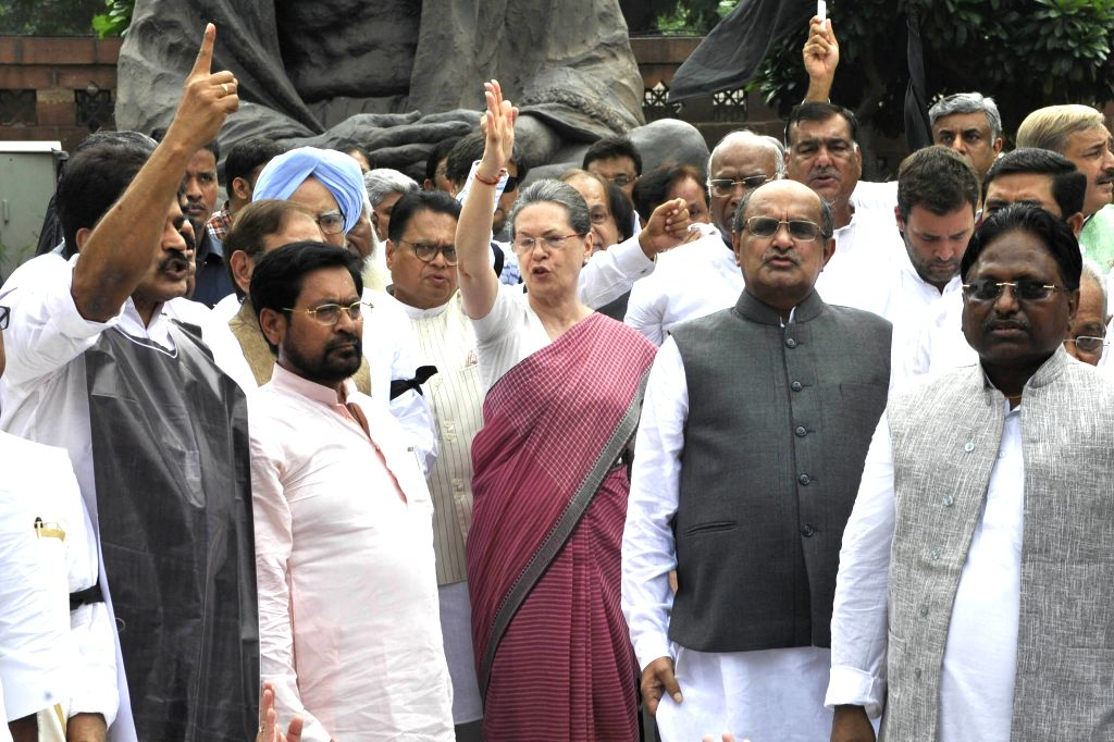 Congress chief Sonia Gandhi, JD(U) general secretary KC Tyagi, former prime minister Manmohan Singh, Congress vice president Rahul Gandhi and other parliamentarians stage a demonstration ... - Manmohan Singh, Sonia Gandhi and Rahul Gandhi