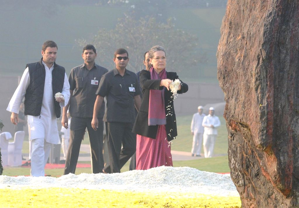 Congress chief Sonia Gandhi pays floral tribute at the memorial of the former Prime Minister Indira Gandhi, on her 98th Birth Anniversary, in New Delhi on Nov 19, 2015. Also seen Congress ... - Sonia Gandhi and Rahul Gandhi