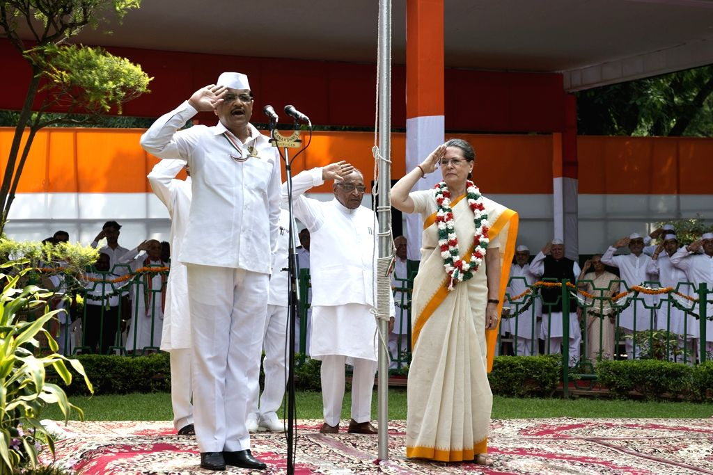 Congress chief Sonia Gandhi salutes the national flag at AICC headquarters on the occasion of 69th ``Independence Day`` celebration in New Delhi, on Aug 15, 2015. - Sonia Gandhi