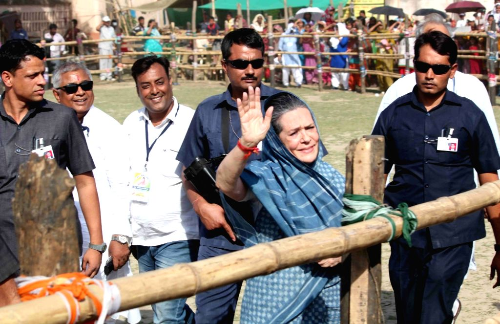Congress chief Sonia Gandhi waves at the crowd as she arrives to address a Left-Congress alliance rally ahead of the third phase of West Bengal Legislative Assembly polls at Sujapur in Malda ... - Sonia Gandhi