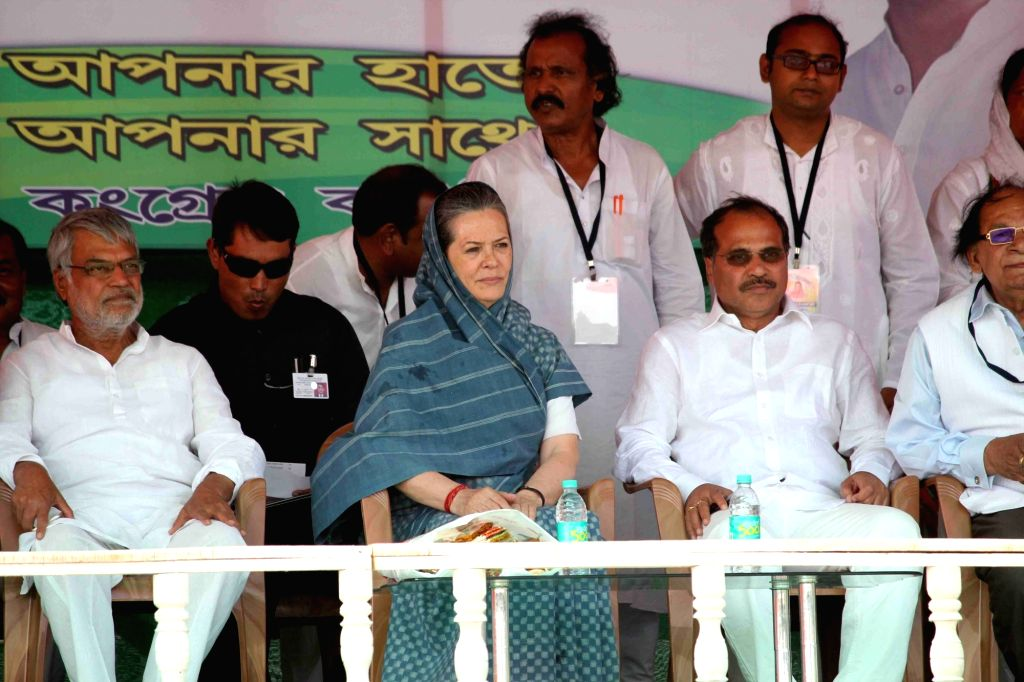 Congress chief Sonia Gandhi with party leader CP Joshi and state Congress chief Adhir Ranjan Chowdhury during a Left-Congress alliance rally ahead of the third phase of West Bengal Legislative ... - Sonia Gandhi