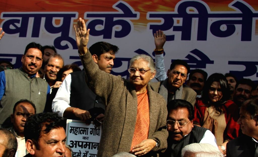 Congress Delhi chief Sheila Dikshit during a demonstration against the insult meted out to Mahatma Gandhi by activists of the Akhil Bharat Hindu Mahasabha (ABHM), in New Delhi on Feb 4, ... - Sheila Dikshit and Nathuram Godse