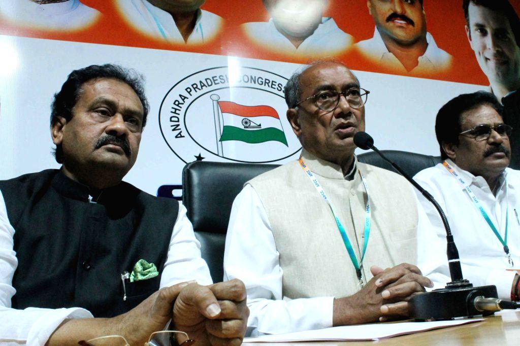 Congress general secretary Digvijay Singh addresses a press conference on Telangana issue at Gandhi Bhavan in Hyderabad on Dec.13, 2013.