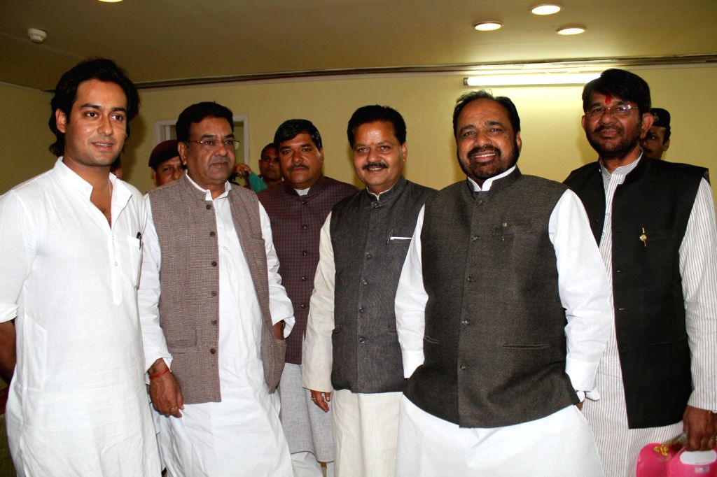 Congress general secretary Digvijay Singh`s son Jaiwardhan Singh with BJP and Congress leaders at the assembly in Bhopal on Dec. 14, 2013.