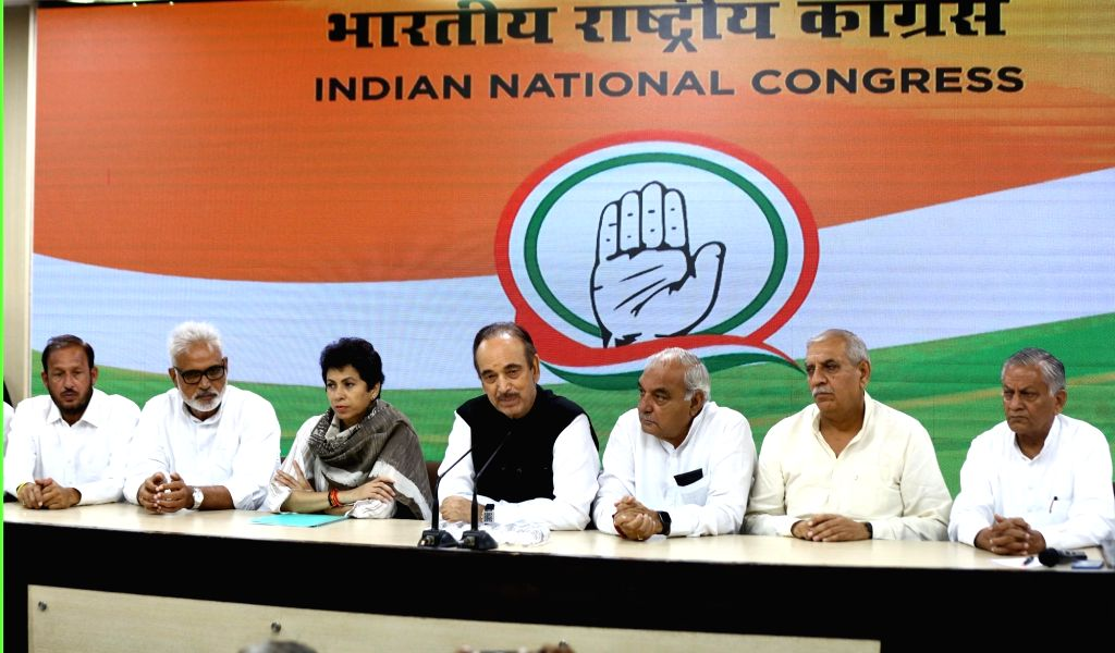 Congress General Secretary Incharge Ghulam Nabi Azad addresses a press conference in New Delhi on Sep 15, 2019. Also seen Congress leaders Bhupinder Singh Hooda and Kumari Selja. - Bhupinder Singh Hooda