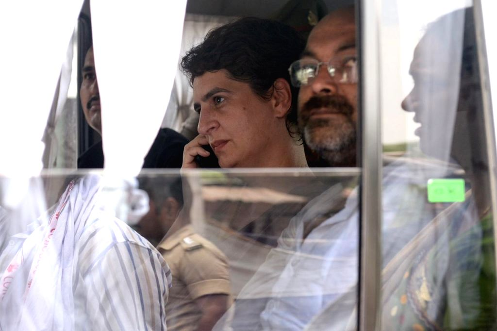 Congress General Secretary Priyanka Gandhi being taken away by the police while she was proceeding for Ubhbha village in Mirzapur after meeting the injured from the Gond community at the ...