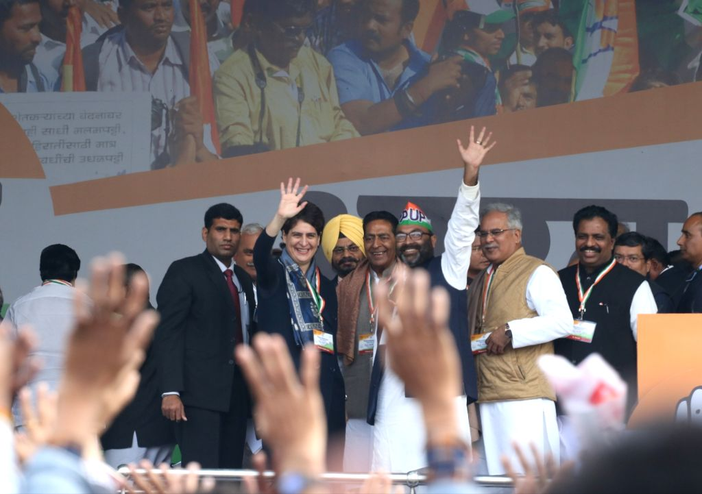 Congress General Secretary Priyanka Gandhi Vadra waves at party workers during 'Bharat Bachao' Rally organised by the party 'against the dictatorship of the BJP government and slaughtering ...