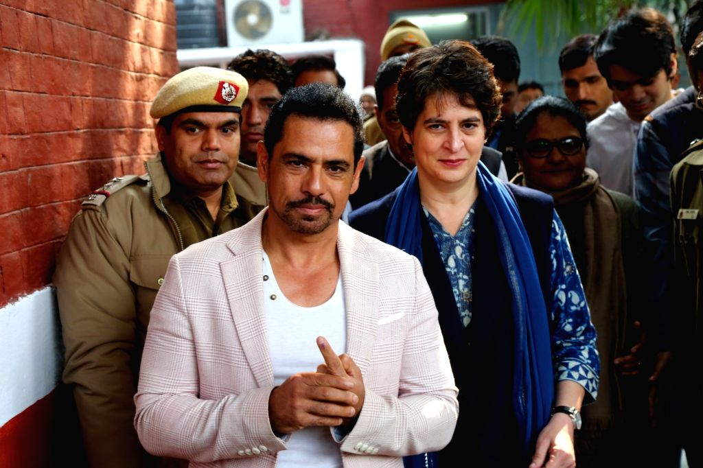 Congress General Secretary Priyanka Gandhi Vadra and her husband Robert Vadra leave after casting their votes for the Delhi Assembly elections 2020 at a polling booth in central Delhi's ...