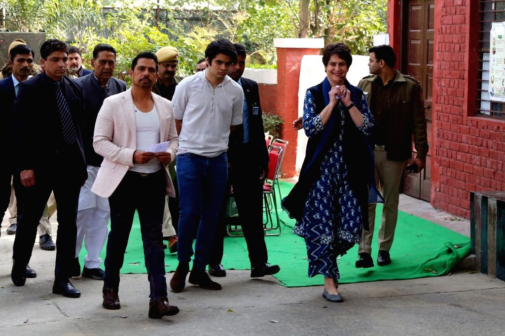 Congress General Secretary Priyanka Gandhi Vadra, her husband Robert Vadra and their son Raihan Vadra arrives to cast their votes for the Delhi Assembly elections 2020 at a polling booth ...