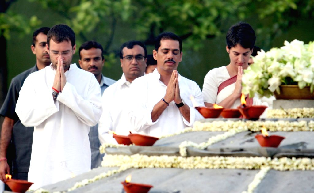 Congress general secretary Rahul Gandhi with his sister Priyanka Vadra and her husband Robert Vadra paying tributes to former Prime Minister Rajiv Gandhi on his death anniversary, at Vir Bhumi in New