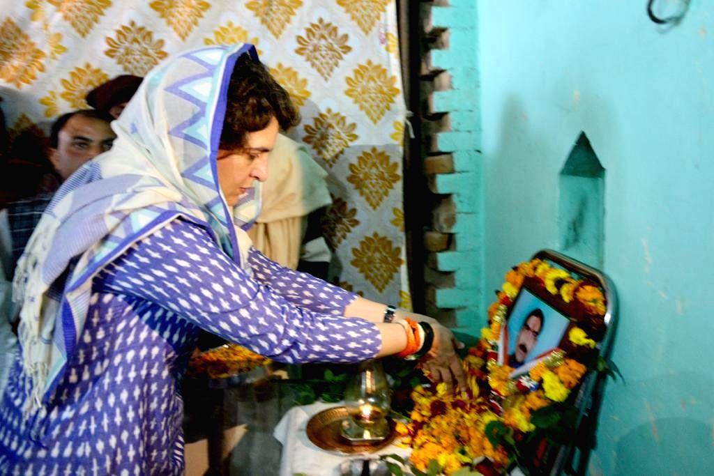 Congress General Secretary (Uttar Pradesh East) Priyanka Gandhi pays tribute to martyr Pradeep Kumar, one of the 40 CRPF personnel killed in 14 Feb Pulwama militant attack; in Uttar Pradesh's ... - Priyanka Gandhi and Pradeep Kumar