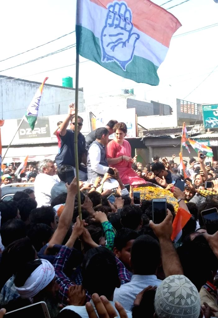 Congress General Secretary (Uttar Pradesh East) Priyanka Gandhi during a roadshow ahead of 2019 Lok Sabha elections, in Uttar Pradesh's Bijnor, on April 9, 2019. - Priyanka Gandhi