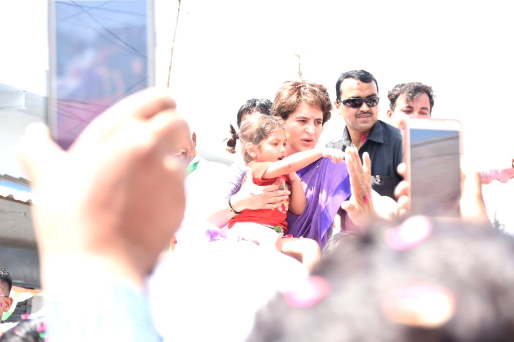Congress General Secretary (Uttar Pradesh East) Priyanka Gandhi Vadra during a roadshow ahead of the 2019 Lok Sabha elections, in Uttar Pradesh's Jhansi, on April 25, 2019. - Priyanka Gandhi Vadra