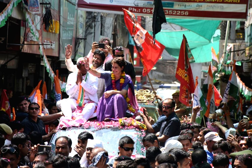 Congress General Secretary (Uttar Pradesh East) Priyanka Gandhi Vadra with the party's Lok Sabha candidate from Jhansi, Shiv Saran Kushwaha during a roadshow ahead of the 2019 Lok Sabha elections, in ... - Priyanka Gandhi Vadra