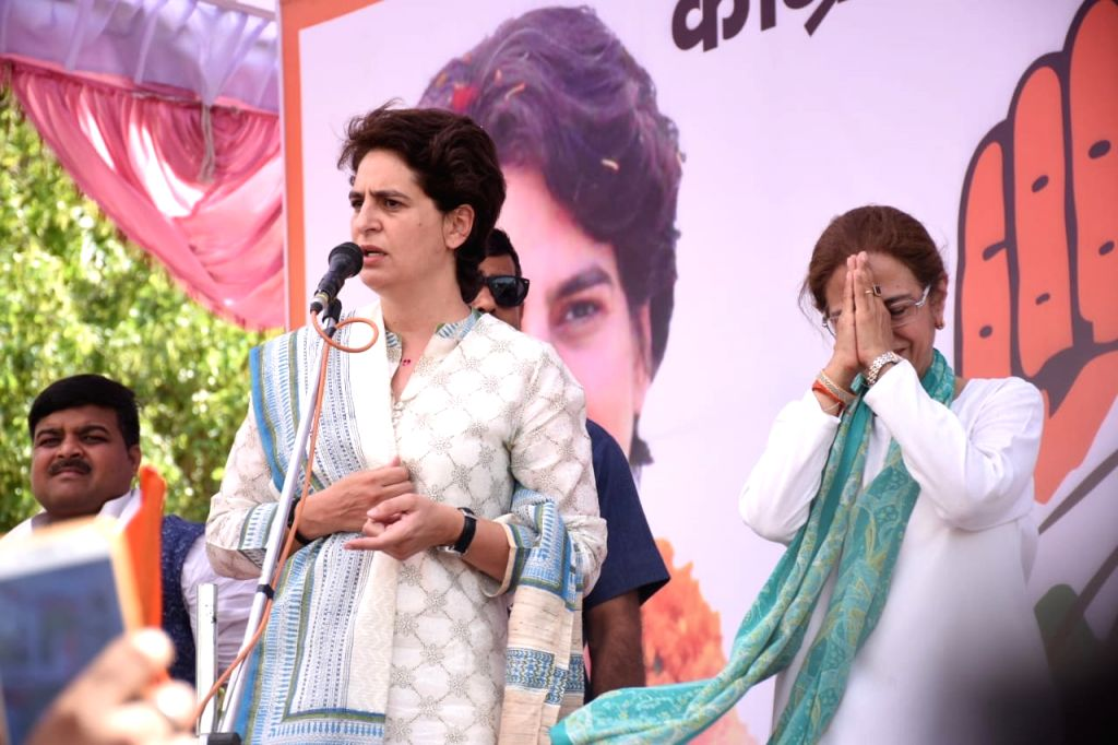 Congress General Secretary (Uttar Pradesh East) Priyanka Gandhi Vadra with the party's candidate from Unnao during a public rally organised ahead of the 2019 Lok Sabha elections, in Uttar ... - Priyanka Gandhi Vadra
