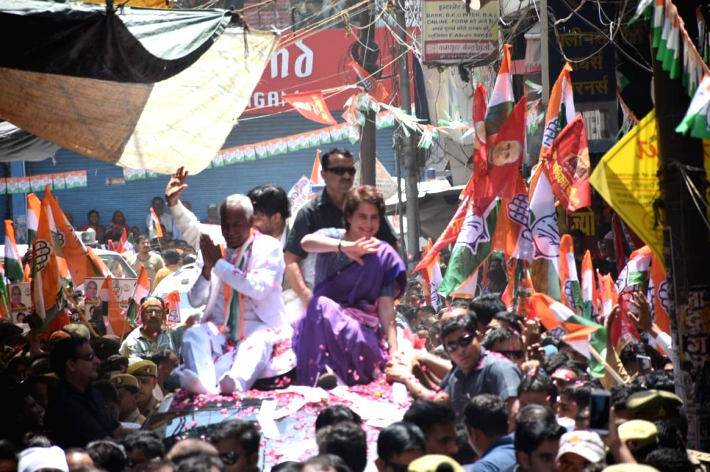 Congress General Secretary (Uttar Pradesh East) Priyanka Gandhi Vadra with the party's Lok Sabha candidate from Jhansi, Shiv Saran Kushwaha during a roadshow ahead of the 2019 Lok Sabha elections, in Uttar Pradesh's Jhansi, on April 25, 2019. (Photo: - Priyanka Gandhi Vadra