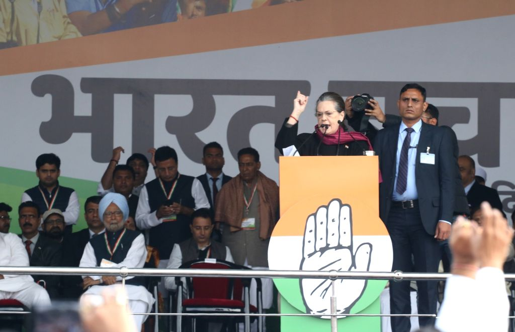 Congress' Interim President Sonia Gandhi addresses during 'Bharat Bachao' Rally organised by the party 'against the dictatorship of the BJP government and slaughtering of Indian economy ... - Sonia Gandhi, Manmohan Singh and Randeep Singh Surjewala