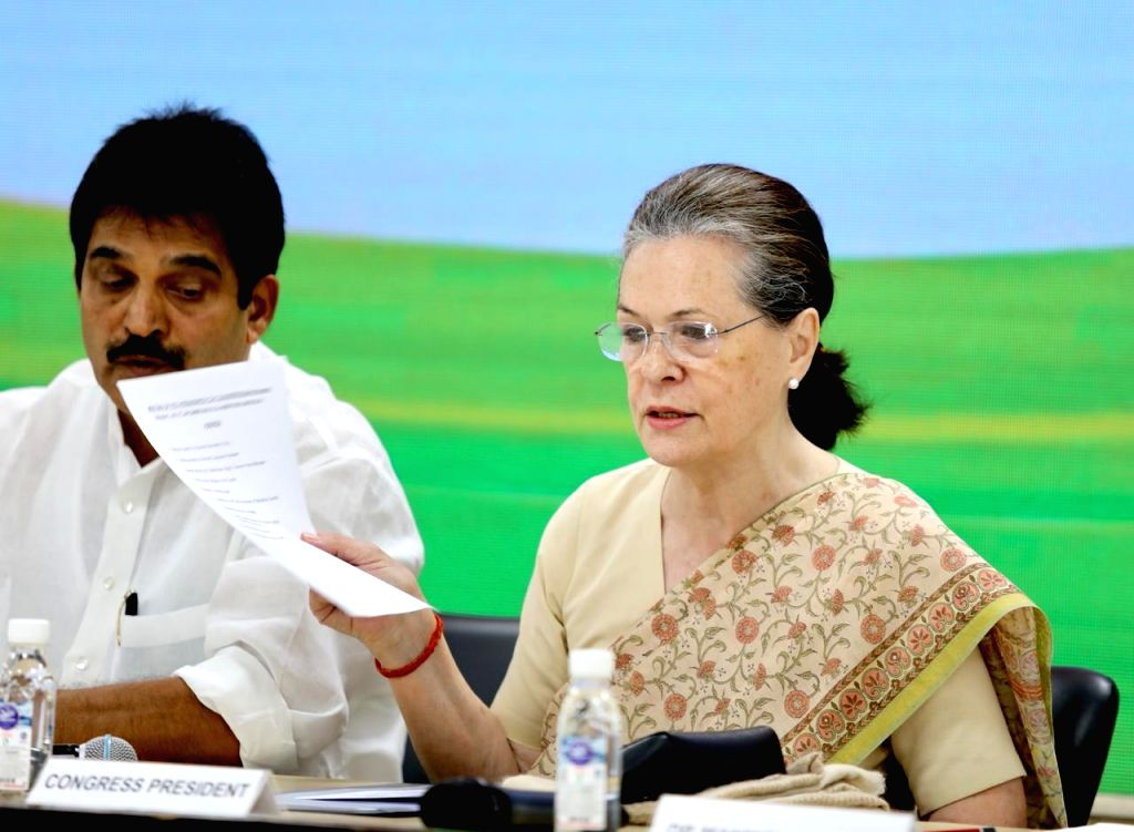 Congress interim President Sonia Gandhi with party leader K. C. Venugopal during a meeting of party general secretaries, state in-charges, state unit chiefs and others at party ... - Sonia Gandhi