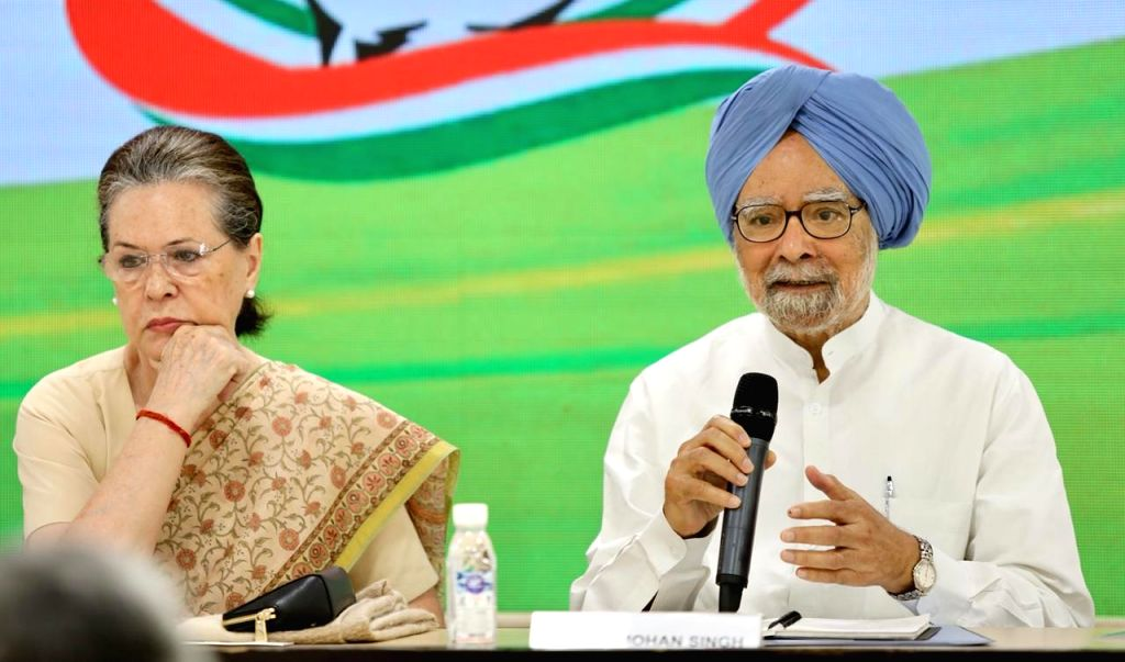 Congress interim President Sonia Gandhi with party leader Dr Manmohan Singh during a meeting of party general secretaries, state in-charges, state unit chiefs and others at party ... - Sonia Gandhi and Manmohan Singh