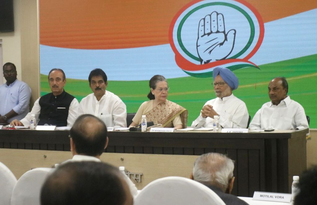 Congress interim President Sonia Gandhi with party leaders Ghulam Nabi Azad, K. C. Venugopal, Dr Manmohan Singh and A. K. Antony during a meeting of party general secretaries, state ... - Sonia Gandhi and Manmohan Singh