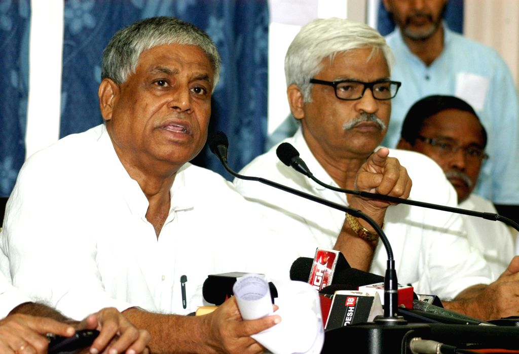 Congress leader Abdul Mannan and CPI-M leader Sujan Chakrabarty during a press conference at West Bengal Assembly in Kolkata June 29, 2016.