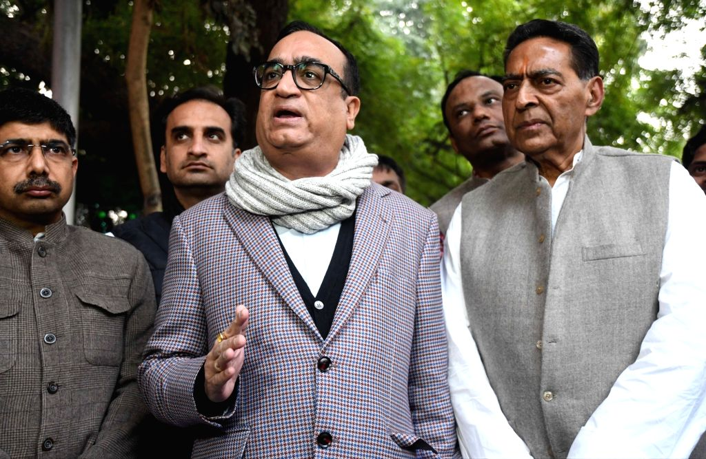 Congress leader Ajay Maken accompanied by Delhi Congress President Subhash Chopra, talks to the media after submitting a complaint with the Election Commission against BJP leaders', ... - Subhash Chopra