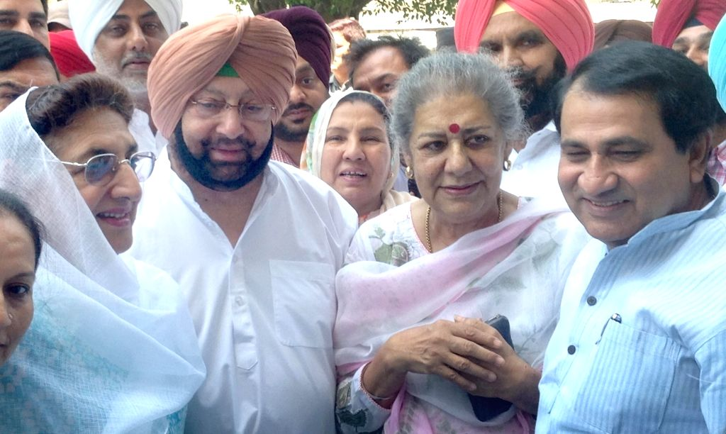 Congress leader Ambika Soni arrives to file nominations for elections to Rajya Sabha at Punjab Assembly in Chandigarh, on May 30, 2016. Also seen party leaders Captain Amarinder Singh and ... - Amarinder Singh