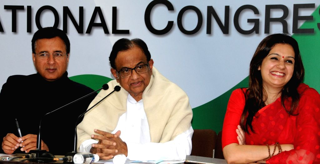 Congress leader and Former Finance Minister P. Chidambaram addresses a press conference in New Delhi on Feb 1, 2019. Also seen Congress leaders Randeep Singh Surjewala and Priyanka ... - P. Chidambaram and Randeep Singh Surjewala