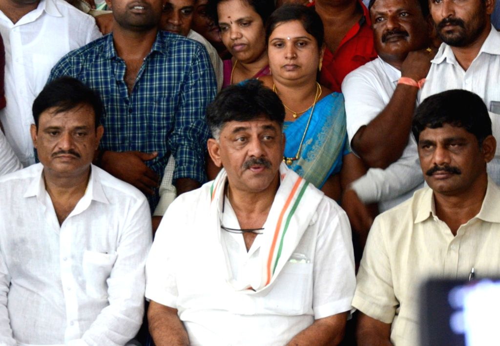 Congress leader and former Karnataka Minster D.K. Shivakumar and his brother MP D. K. Suresh during a press conference over CBI search warrants against them, in Bengaluru on May 31, 2018. ...