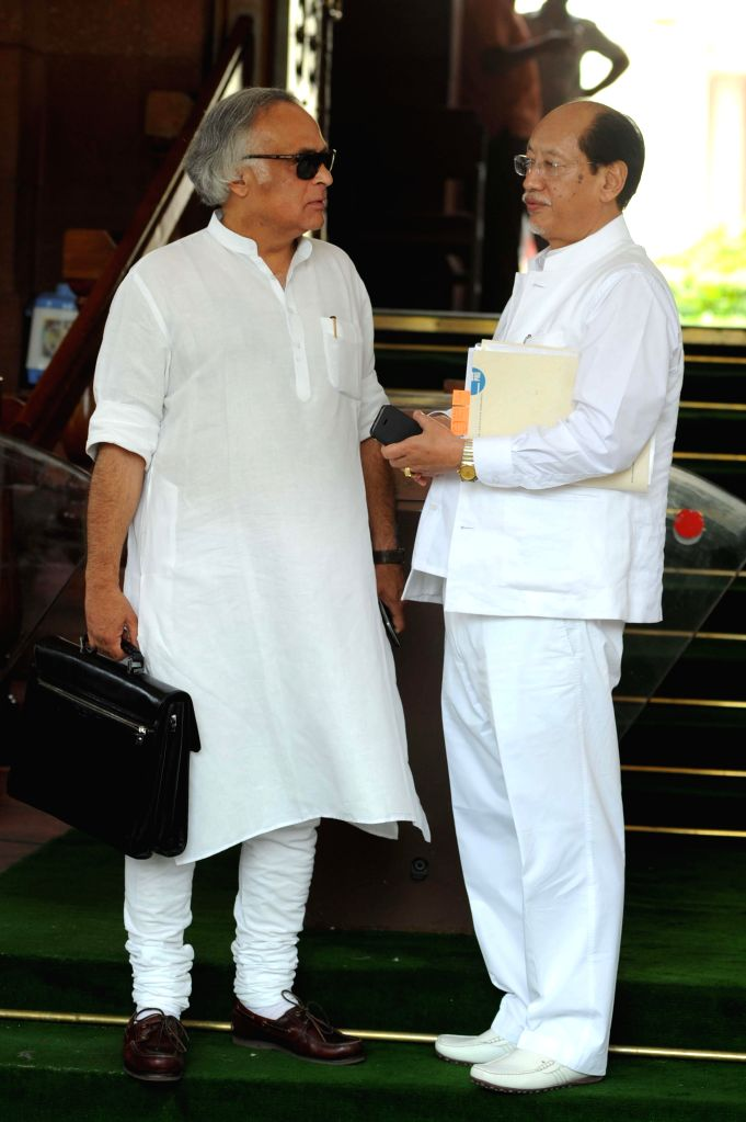 Congress leader and MP Jairam Ramesh and Nagaland MP Neiphiu Rio at the Parliament in New Delhi on July 16, 2014.