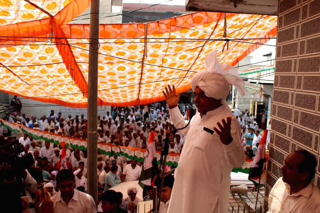 Congress leader and star campaigner Bhupinder Singh Hooda addresses a gathering during an election rally ahead of Haryana Assembly polls, in Meham on Oct 17, 2019. The state will go to polls ... - Bhupinder Singh Hooda