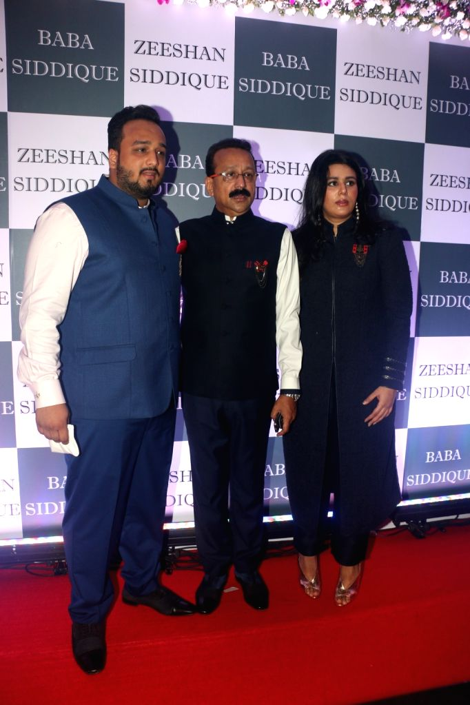 Congress leader Baba Siddique with his children Zeeshan Siddique and Arshia Siddique during an Iftar party in Mumbai, on June 2, 2019.