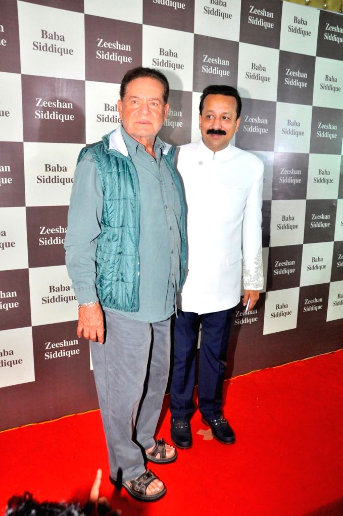 Congress leader Baba Siddique with Salim Khan during his Iftar party, in Mumbai, on June 24, 2017. - Khan