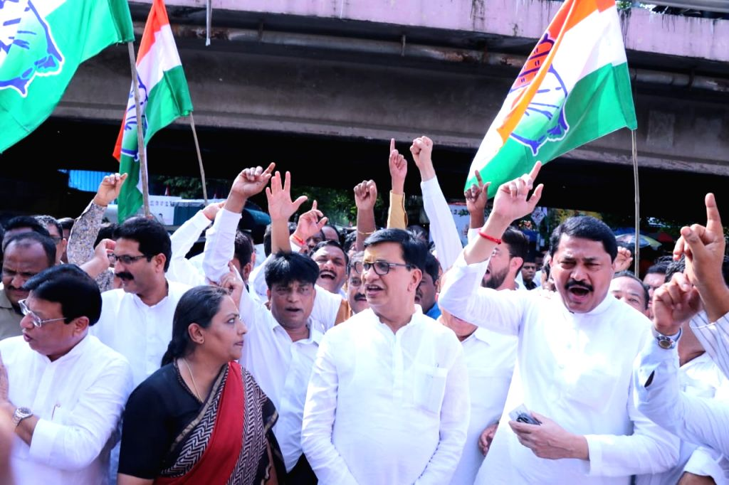 Congress leader Balasaheb Thorat leads a protest against the detention of Congress leader Priyanka Gandhi by the Uttar Pradesh police when she was proceeding to meet the victims of the ... - Priyanka Gandhi