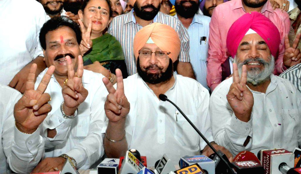 Congress leader Captain Amarinder Singh addresses a press conference after winning Amritsar Lok Sabha Seat in Amritsar on May 16, 2014.