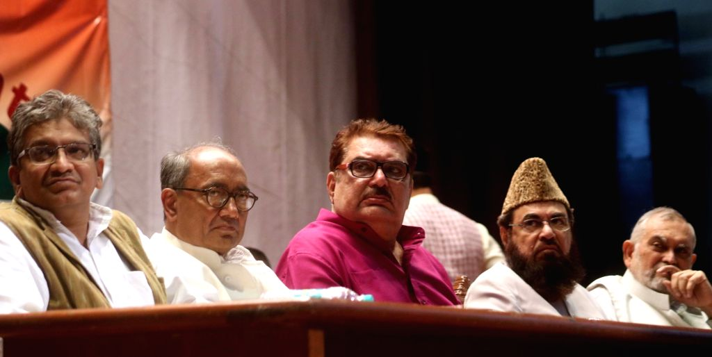 Congress leader Digvijay Singh, Raza Murad and others during a symposium on beef export ban in New Delhi, on Aug 11, 2016. - Digvijay Singh